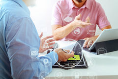 Businessmen working together on a document and using smart phone. And digital tablet and laptop computer in modern office with VR icon diagram Stock Photography