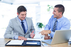 Businessmen working together with laptop Stock Photo