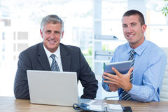 Businessmen working together with laptop and tablet Royalty Free Stock Images