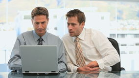 Businessmen working together in a office stock video