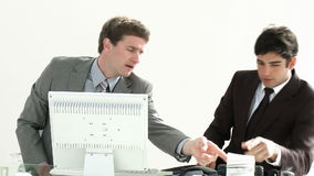 Businessmen working together in an office. Business coworkers helping each  other in HD1080p stock footage