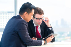 Businessmen working together in office Stock Images
