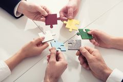 Teamwork of partners. Concept of integration and startup with puzzle pieces Stock Photography