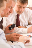 Businessmen working  on a white Royalty Free Stock Photography