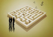 Businessmen with yellow maze and money symbols Stock Photography