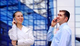Businessmens calling by phone Royalty Free Stock Photos