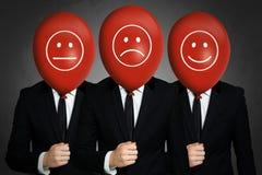 Businessmens con los globos rojos Imágenes de archivo libres de regalías