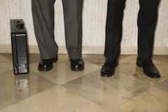 Businessmens legs Stock Photography