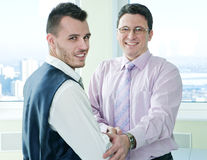 Businessmens shaking hand with colleague Stock Image