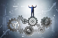 The businessnman in teamwork concept with cogwheels Royalty Free Stock Images