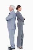 Businesspartner, das zurück zu Rückseite steht Lizenzfreies Stockfoto