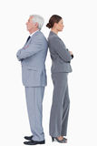 Businesspartner standing back to back Royalty Free Stock Photo