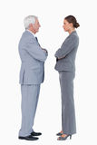Businesspartner standing face to face with arms folded Royalty Free Stock Photography