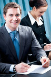 Businesspeople. Or business person and client royalty free stock image