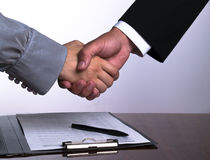 Businesspeople. Business people in the office shaking hands after sign up the contract royalty free stock photos