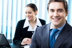 Businesspeople. Two happy businesspeople, at office stock photography