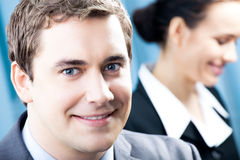 Businesspeople. Two smiling businesspeople at office stock images