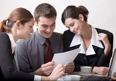 Businesspeople. Businessman and two businesswomen at work Stock Photography