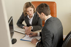 Businesspeople. Businesspeole working in the office Royalty Free Stock Photo