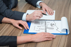 Businesspeople analyzes charts Stock Photo