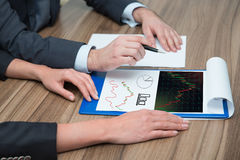 Businesspeople analyzes stock charts Stock Photos