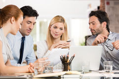 Businesspeople analyzing documents Royalty Free Stock Photos