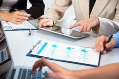 Businesspeople analyzing financial data Stock Image