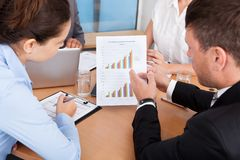 Businesspeople analyzing graph Stock Photo