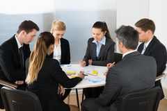 Businesspeople analyzing graph in office stock photos