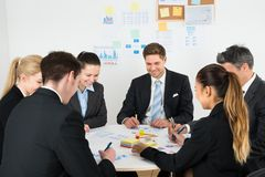 Businesspeople analyzing graph in office royalty free stock photography