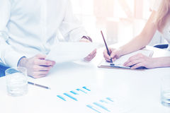 Businesspeople analyzing report with graphs Royalty Free Stock Images
