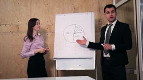 Businesspeople answer question during presentation stock video