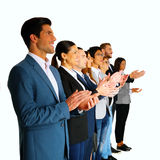 Businesspeople applauding. A Group of businesspeople applauding stock image