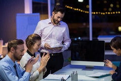 Businesspeople applauding on their colleagues presentation Stock Photos