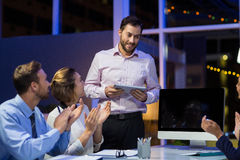 Businesspeople applauding on their colleagues presentation Stock Photo