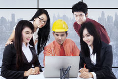 Businesspeople and architect discussing in office Stock Image