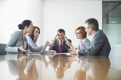 Businesspeople arguing in meeting Stock Photography