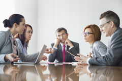 Businesspeople arguing in meeting royalty free stock images