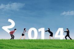 Businesspeople arrange new year 2014 outdoor. New business arrangement concept with bussinesspeople arrange new year of 2014 Royalty Free Stock Photo