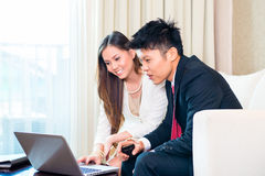 Businesspeople in Asian hotel room Stock Photography