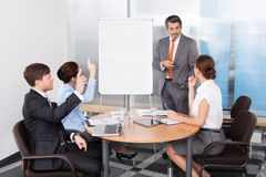 Businesspeople asking question to businessman Royalty Free Stock Image