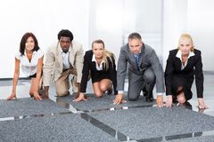 Businesspeople being ready for race Stock Images