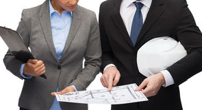 Businesspeople with blueprint and helmet Royalty Free Stock Images