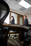 Businesspeople in boardroom Stock Images