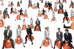 Businesspeople Bouncing On Inflatable Balls. Isolated over white background stock images
