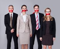 Businesspeople bound by red tape Stock Photography