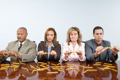 Businesspeople breaking pencils Royalty Free Stock Photo