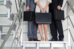 Businesspeople With Briefcases Standing On Steps Royalty Free Stock Image