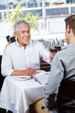 Businesspeople at business lunch Stock Photography