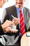 Businesspeople in business office drink coffee Stock Photo